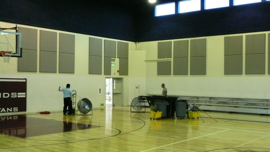 Grey acoustic wall panels for gymnasiums