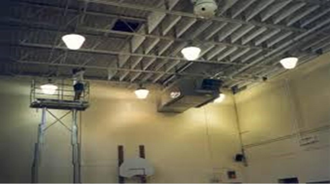 Acoustic baffles being installed into a gym